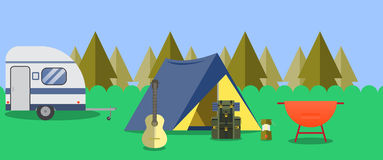 Camping in the woods. Next to the tent is a backpack, a guitar and lamp Stock Images