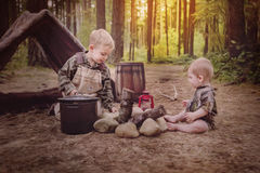 Camping. Young boy with brother camping royalty free stock photo