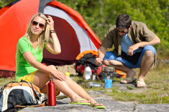 Camping young couple with tent cook countryside Stock Photos