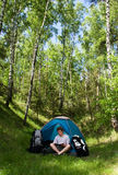 Camping: Young Man Reading Royalty Free Stock Photos