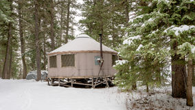 Camping yurt in winter with trees and snow Royalty Free Stock Photo