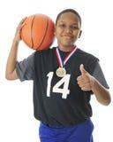 Campione di pallacanestro del Preteen Immagini Stock Libere da Diritti