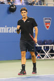 Campione Roger Federer del Grande Slam di diciassette volte durante la partita di quarto di finale all'US Open 2014 contro Gael M Fotografie Stock Libere da Diritti