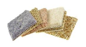 Campioni del tappeto su un fondo bianco Fotografie Stock