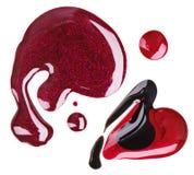 Campioni rossi, viola e neri della macchia dello smalto di chiodo fotografia stock