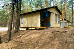 Campisites in pine forest, health lifestyle. Relaxation and harmony. Wooden houses, campisites in pine forest, health lifestyle. Relaxation and harmony stock images