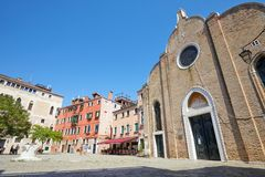 Campo Bandiera e Moro square with people and brick church in Venice, Italy. VENICE, ITALY - AUGUST 15, 2017: Campo Bandiera e Moro square with people and San royalty free stock image