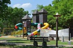 Campo da giuoco dei bambini nel parco Fotografie Stock