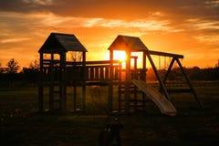 Campo da giuoco e tramonto Immagine Stock