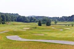 Campo da golf nuvoloso Immagine Stock