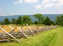 Campo de batalha da guerra civil com cerca Foto de Stock Royalty Free