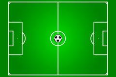 Campo de fútbol con la bola Fotos de archivo libres de regalías