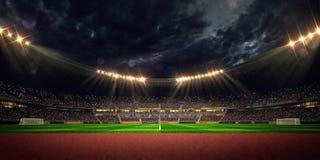 Campo de fútbol de la arena del estadio de la noche Fotografía de archivo
