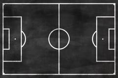 Campo de fútbol en la pizarra negra imagenes de archivo