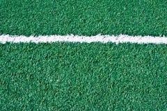 Campo de fútbol falso de la hierba Foto de archivo libre de regalías
