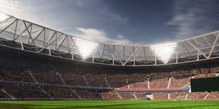 Campo de fútbol de la arena del estadio de la tarde Imágenes de archivo libres de regalías