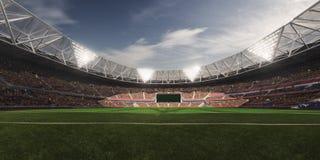 Campo de fútbol de la arena del estadio de la tarde Fotografía de archivo libre de regalías
