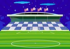 Campo de fútbol y tribunas. Imágenes de archivo libres de regalías