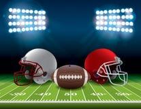 Campo de fútbol americano con los cascos y el ejemplo de la bola Imagenes de archivo
