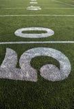 Campo de futebol americano e números de linha de jardas Foto de Stock Royalty Free
