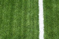 Campo de futebol com linhas brancas na grama Imagens de Stock Royalty Free