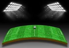 Campo de futebol com um gramado sob luzes Fotografia de Stock Royalty Free