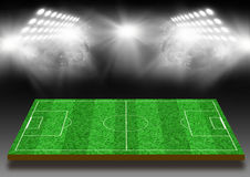Campo de futebol com um gramado sob luzes Imagem de Stock