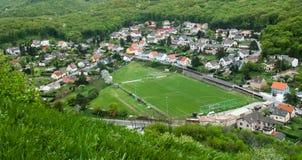 Campo de futebol em uma cidade pequena Foto de Stock Royalty Free