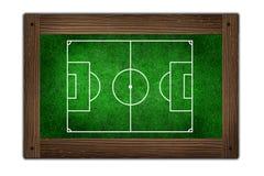 Campo de futebol no frame de madeira Imagens de Stock