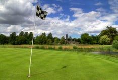Campo de golf con la abadía Imagenes de archivo