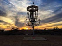Campo de golf del disco en la puesta del sol Fotos de archivo libres de regalías