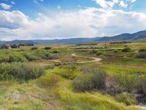 Campo de golf en Colorado rural por una pradera Foto de archivo