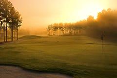 Campo de golf en el amanecer Fotos de archivo libres de regalías