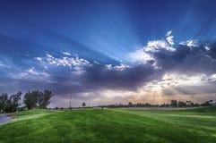 Campo de golf en la puesta del sol Imagenes de archivo