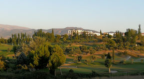 Campo de golf en la puesta del sol Imágenes de archivo libres de regalías