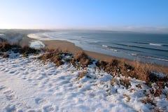 Campo de golf nevado costero Imagen de archivo libre de regalías