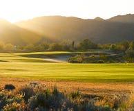 Campo de golfe no por do sol Imagem de Stock