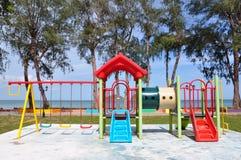 Campo de jogos colorido na praia Fotografia de Stock Royalty Free