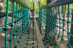 Campo de jogos com ponte de suspensão Fotos de Stock