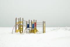 Campo de jogos das crianças no inverno Fotografia de Stock