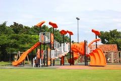 Campo de jogos no jardim. Foto de Stock