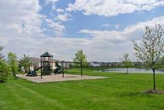 Campo de jogos pelo lago Imagens de Stock