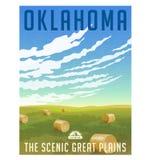 Campo de Oklahoma con el cartel redondo de las balas de heno