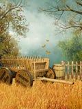 Campo de trigo con un carro Fotos de archivo libres de regalías