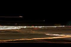 Campo degli indicatori luminosi astratti di notte Fotografia Stock