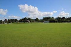 Campo del cricket al club di Sparta nella foresta di Schollenbos in Capelle aan den IJssel fotografia stock