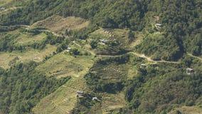 Campo del riso e del villaggio Regno del Bhutan Fotografia Stock Libera da Diritti