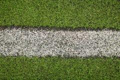 Campo di calcio artificiale verde dell'erba I precedenti verdi Immagine Stock