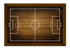 Campo di calcio nel telaio di legno. Immagine Stock