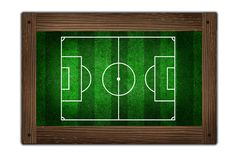Campo di calcio sul blocco per grafici di legno Immagine Stock